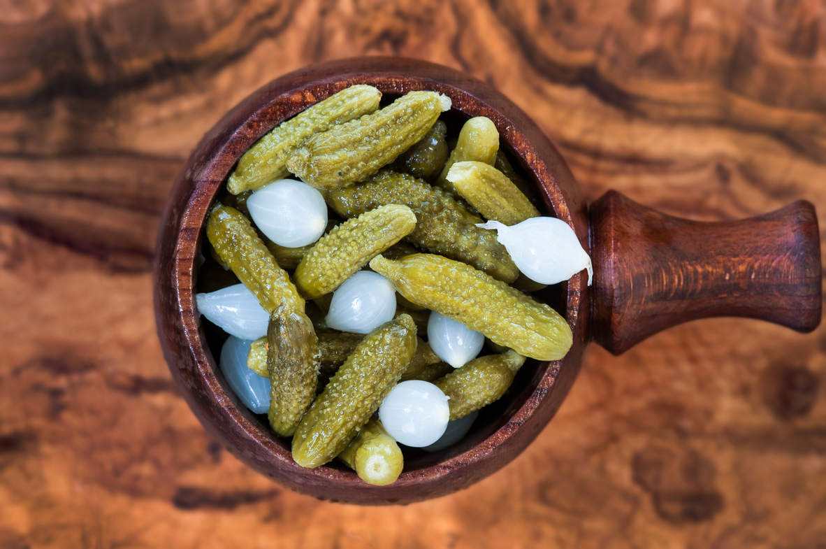 Cornichons infused with oninios,Wine Vinigar and Mustard seeds